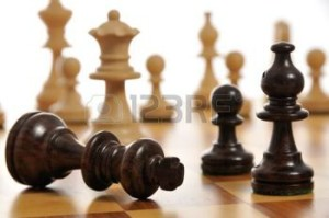 3260546-the-black-king-surrendering-on-a-chess-board